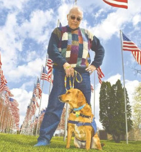 King with his foster trainer, Joe Zentis, on the Avenue of 444 Flags